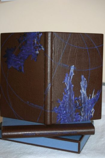 Reliure de création plein cuir décor planisphère